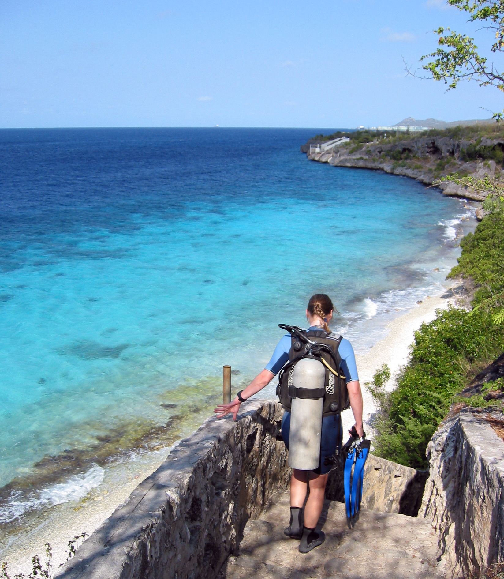 A diver before descending the steps to this Bonaire dive site.