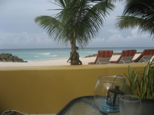 wall separates breakfast area from sandy beach - nice